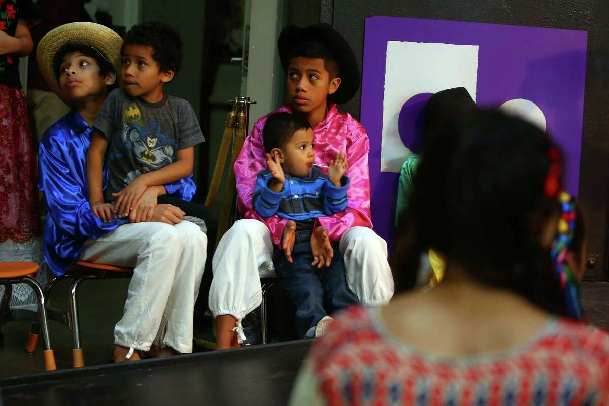 Performers wait to take the stage at the annual Dia de los Muertos event at the Seattle Center Armory, Sunday, Nov. 1, 2015.