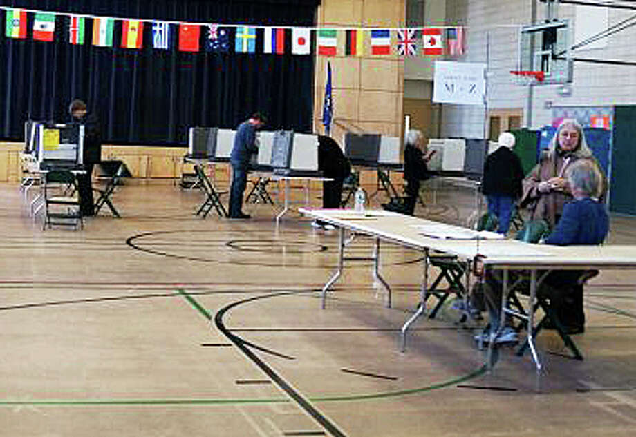 Voting takes place today in the town's 2015 municipal election. Here, voters cast ballots at the McKinley School polling station in an earlier election. Photo: File Photo / File Photo / Fairfield Citizen