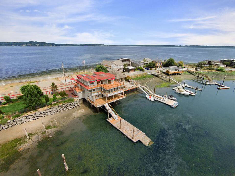 Point Monroe on Bainbridge Island give people who live there views of both Puget Sound and a salt-water lagoon. This house is at 15711 Point Monroe Drive N.E. The full listing is here. Photo: Ty Evans/Windermere