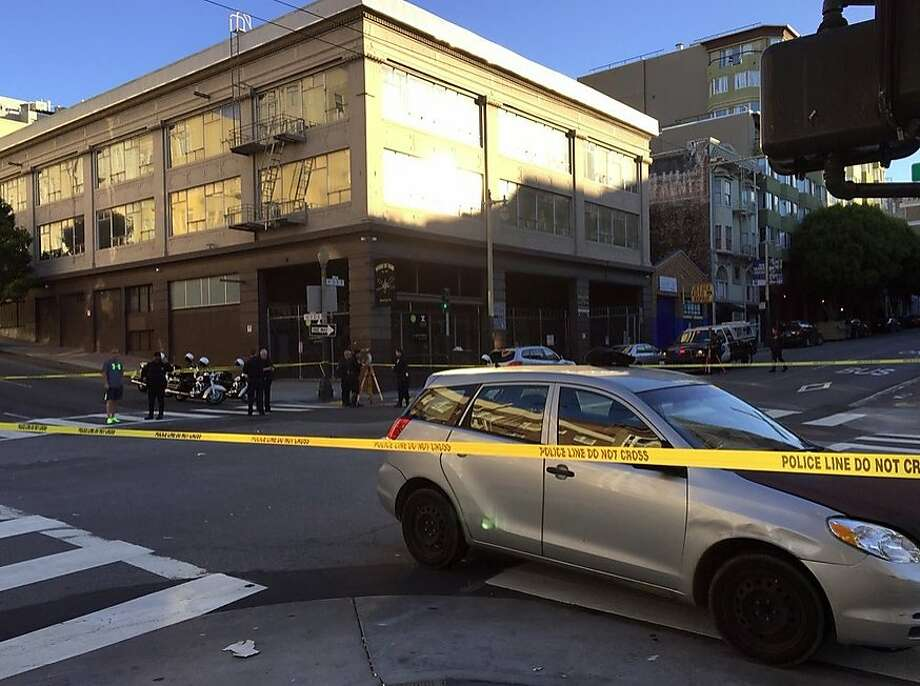 A jogger suffered critical injuries after being struck by a car in San Francisco's Tenderloin neighborhood the morning of Tuesday, Nov. 3, 2015. Photo: Evan Sernoffsky