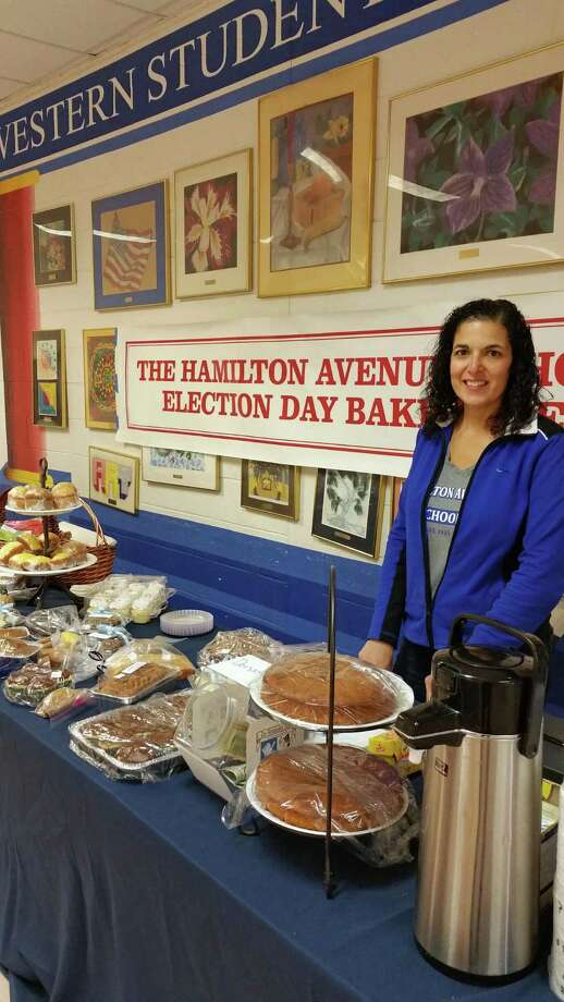 Hamilton Avenue PTA President Cathy Fiorito-Brunetti manned the tables at the school's bake sale this morning for election day. Photo: Contributed / Contributed Photo / Greenwich Time Contributed