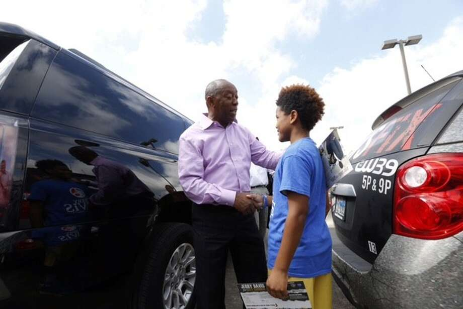 Mayoral candidate Sylvester Turner talks with voters and the media on Election Day in Houston, Tuesday, Nov. 3, 2015. Photo: Cody Duty | Houston Chronicle