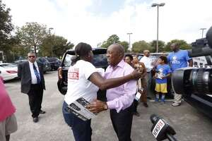 Mayoral candidate Sylvester Turner talks with voters and the media on Election Day in Houston, Tuesday, Nov. 3, 2015.