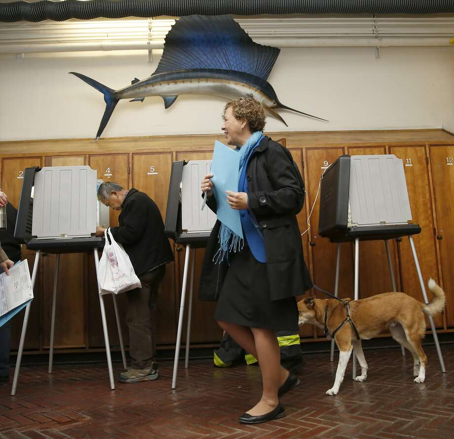 District three candidate Julie Christensen votes with her dog Cooper at the firehouse on Stockton at Greenwich streets in San Francisco, Calif., on Tuesday, November 3, 2015. Photo: Liz Hafalia, The Chronicle