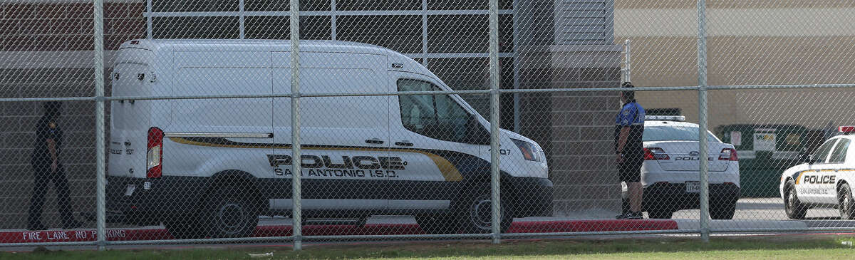 San Antonio Independent School District police cars iare parked on the north side of Burbank High School Tuesday November 3, 2015 after a bullet allegedly shattered a window. The school was briefly placed on lockdown.
