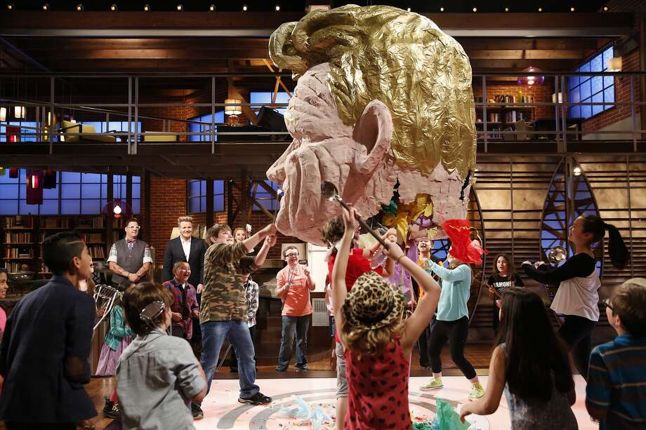 "J.J. O'Day of Santa Fe, Tx., center in camouflage, takes a whack at a pinata shaped as Gordon Ramsay in the premiere episode of season four of ""MasterChef Junior,"" which airs Nov. 6 on Fox. Photo: Greg Gayne/Fox"
