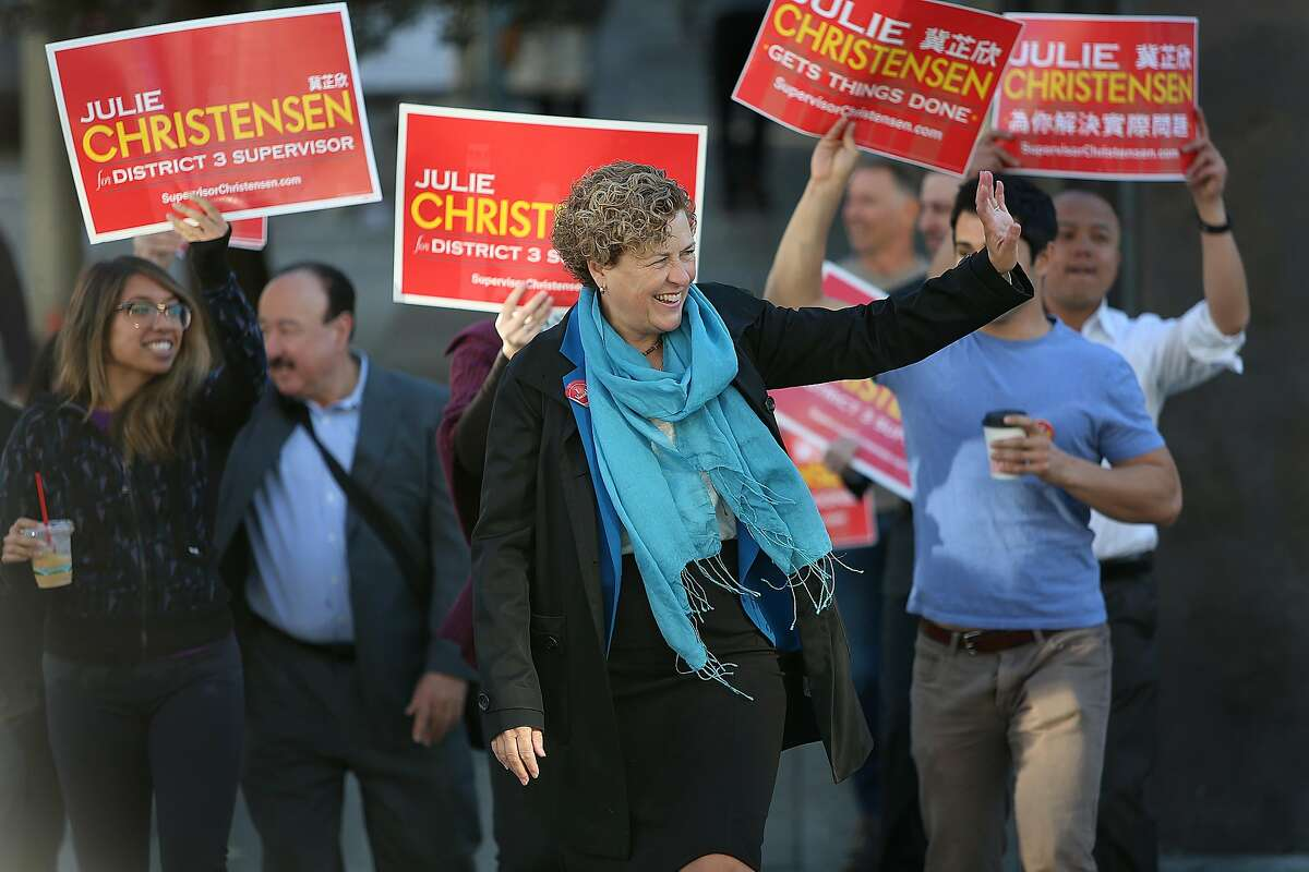 District three candidate Julie Christensen (middle) walks down Polk St. with her supporters in San Francisco, Calif., on Tuesday, November 3, 2015.