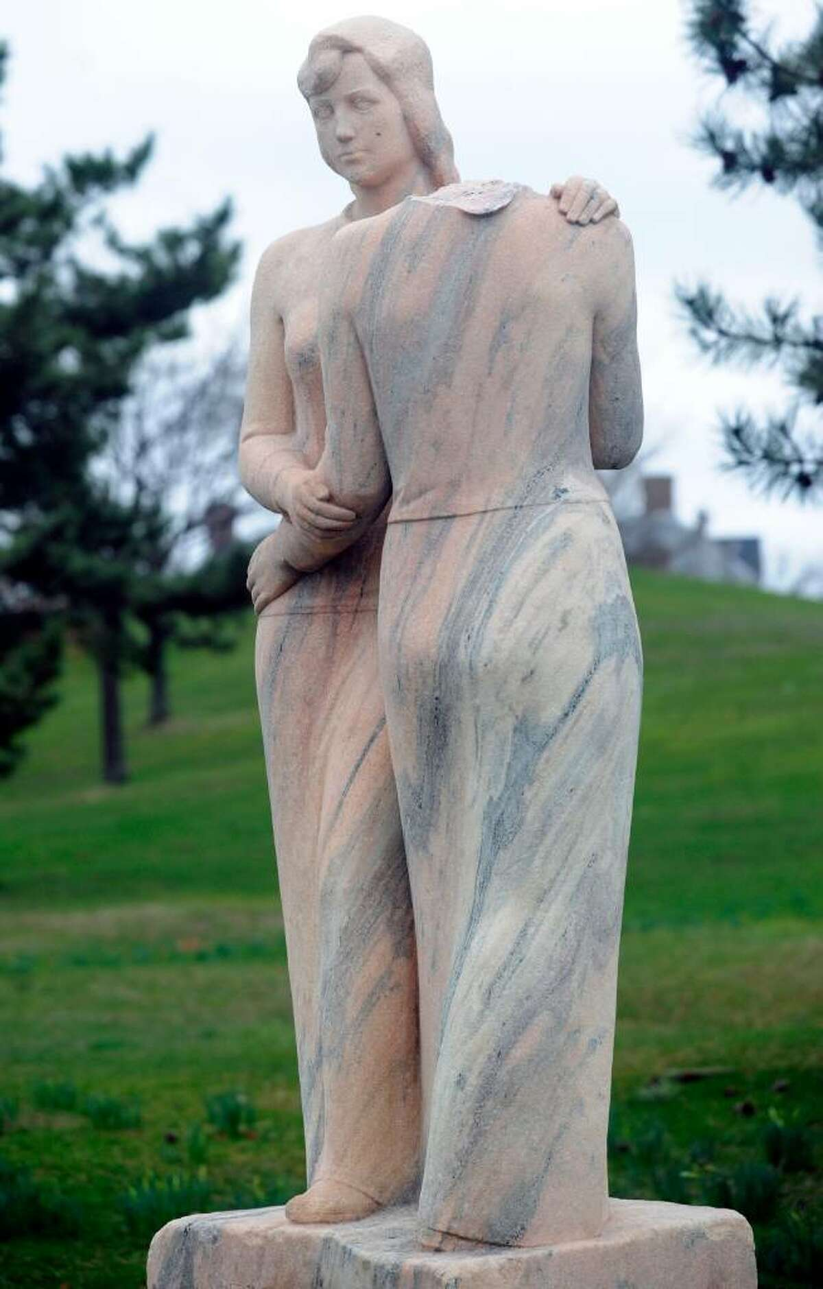 """""""Neighbors,"""" a depression era statue by Henry Kreis, stands in Czecik Marina Park on Shippan Avenue March 28, 2010. The statue, which depicts two women embracing, was damaged when the head of one of the women was cut off and taken. It was funded by the Works Progress Administration, an agency created to generate jobs in the late 1930s."""