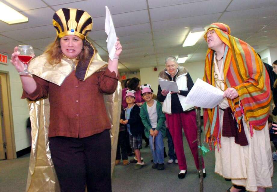 Jane Aronson, 7th grade teacher and past director of education at the Greenwich Reformed Synagogue Hebrew School, plays the pharoh, fighting with Rabbi Andrew Sklarz as Moses, in the reenactment of the Jews' exodus from Egypt, on Sunday, March 28, 2010. Photo: Helen Neafsey / Greenwich Time