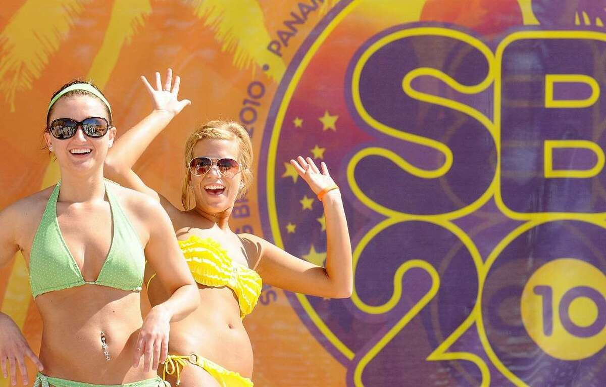 This photo taken Saturday, March 6, 2010, shows Chelsie Haltom and Mary Higgins enjoying Spring Break in Panama City Beach, Fla. (AP Photo/The News Herald, Andrew Wardlow) MANDATORY CREDIT.