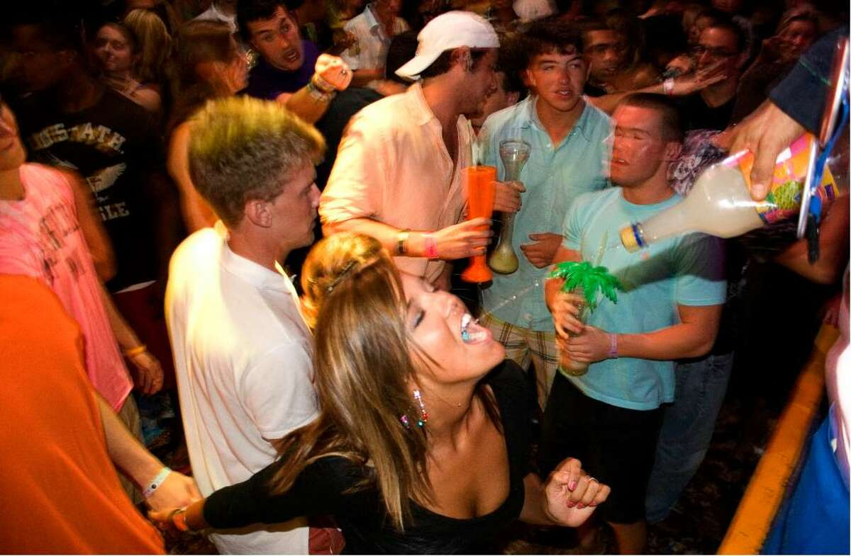 A spring break reveler gets a swig of margarita at the Mr. Frogs nightclub in the resort city of Cancun, Mexico lat night Thursday, March 18, 2010. Mexico's spring break king, the Caribbean resort of Cancun, is rebounding quickly from last year's triple blow to its tourism industry caused by the country's swine flu epidemic, drug violence and a global economic crisis. (AP Photo/Israel Leal)