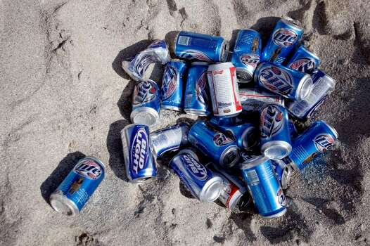 MIAMI BEACH - MARCH 16: A pile of beer cans lays in the sand sun during spring break on South Beach March 16, 2007 in Miami Beach, Florida. Students from universities and colleges around the country are attending spring break which starts at the end of February and into mid-April. (Photo by Joe Raedle/Getty Images) Photo: Joe Raedle, Getty Images / 2007 Getty Images