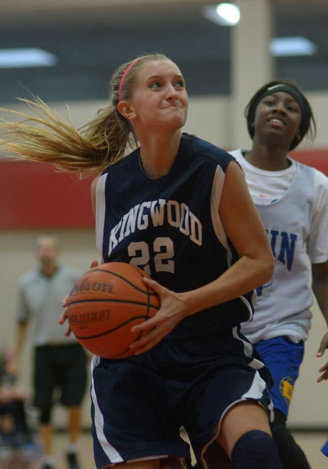 Kingwood senior Haley Schoettelkotte drives to the basket against Klein during a scrimmage last week. Photo: Jerry Baker, Freelance