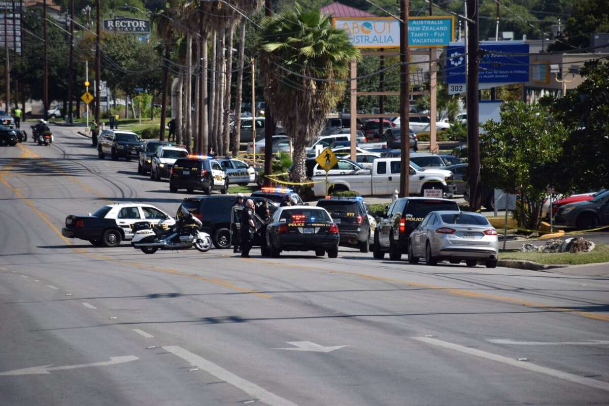 San Antonio police closed Rector Avenue near North Star Mall after an armed man barricaded himself in a nearby health clinic on Nov. 3, 2015.