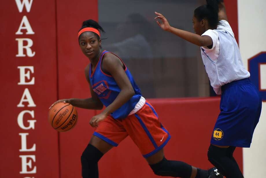 Oak Ridge freshman guard/forward Alecia Whyte, left, works the ball against a Klein defender during their scrimmage last week. Photo: Jerry Baker, Freelance