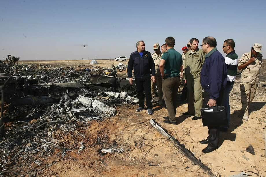 Russian Emergency Situations Minister Vladimir Puchkov (left) and Transport Minister Maxim Sokolov talk Sunday at the crash site in Hassana, Egypt. Photo: Maxim Grigoriev, Associated Press