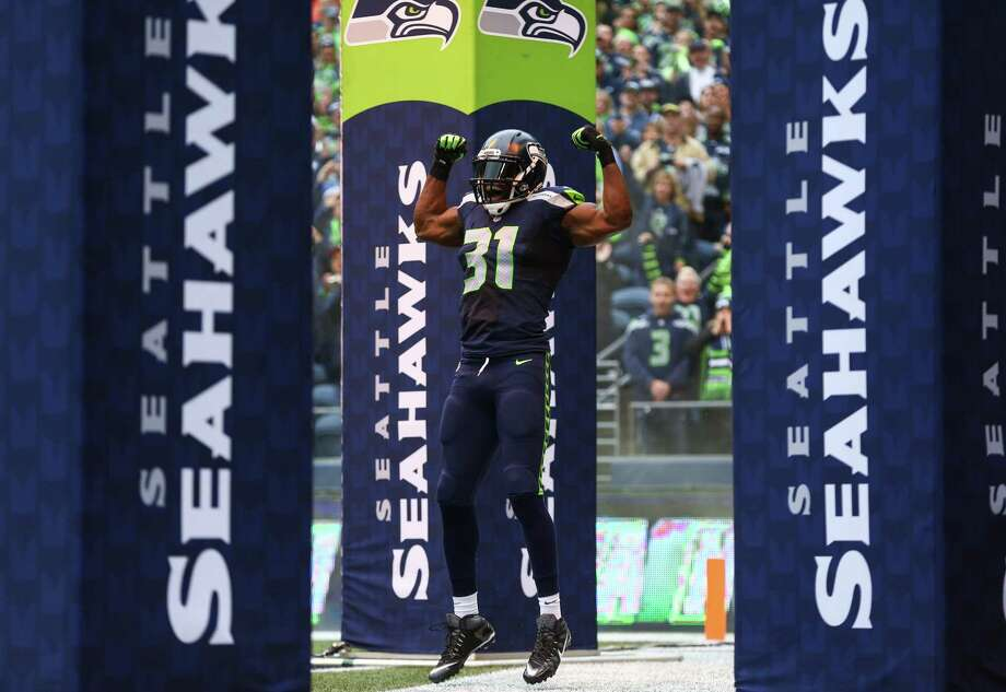 Seattle Seahawks strong safety Kam Chancellor take the field against the Carolina Panthers on Sunday, October 18, 2015. Photo: JOSHUA TRUJILLO, Seattlepi.com / SEATTLEPI.COM