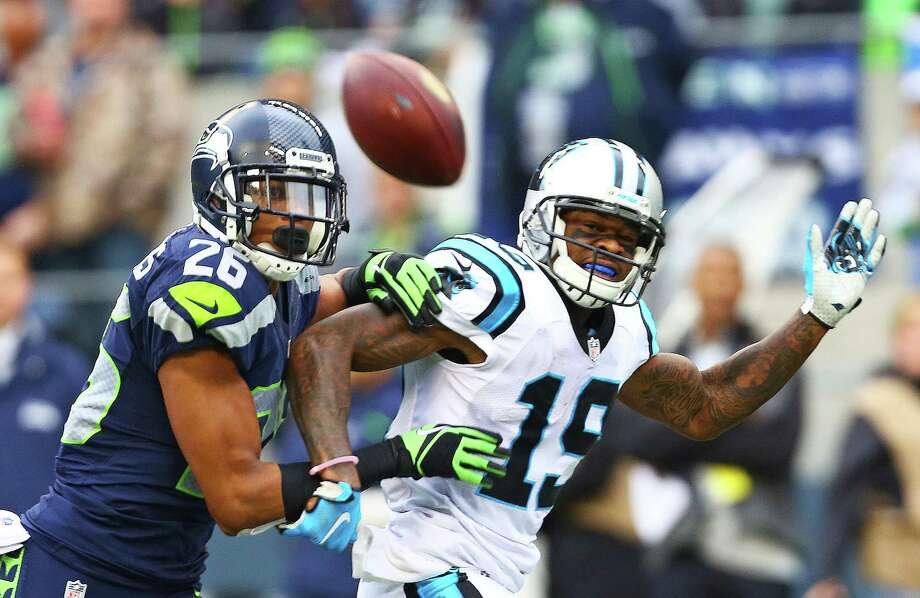 Seattle's Cary Williams covers Carolina's Ted Ginn Jr. in the second half  of the Seahawks game against the Panthers, Sunday, October 18, 2015. Photo: GENNA MARTIN, Seattlepi.com / SEATTLEPI.COM