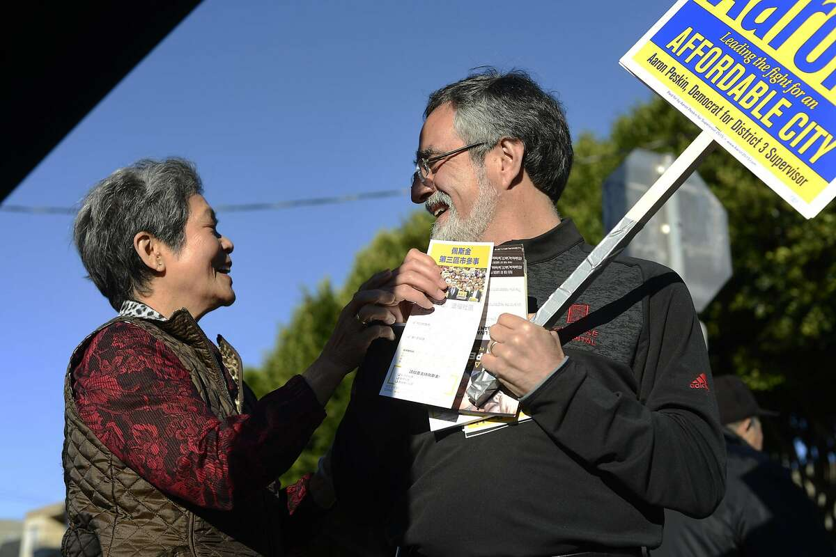Aaron Peskin, San Francisco District 3 supervisor candidate, and Mei Tran, 74, talk about his campaign in San Francisco, Calif., on Tuesday, Nov. 3, 2015.