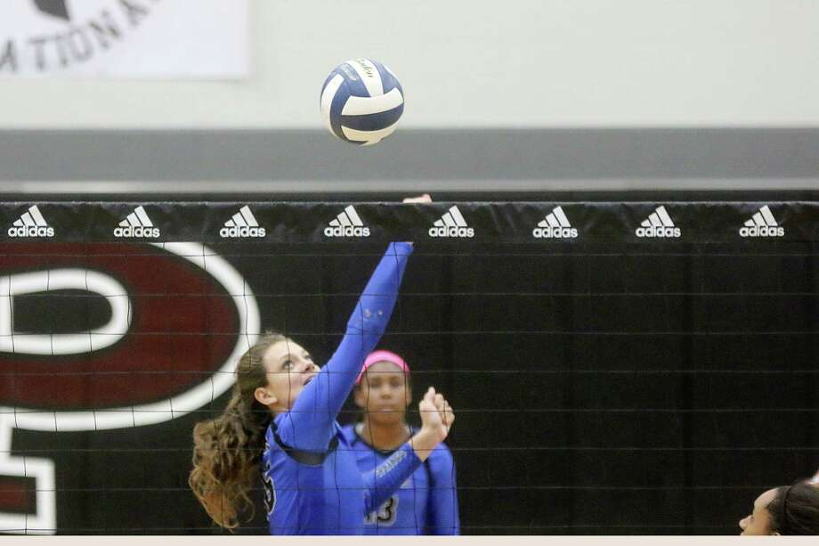 Clear Springs' Elizabeth Armstrong tips the ball over the net in a win over Clements. Photo: Pin Lim, Freelance / Copyright Forest Photography, 2015.