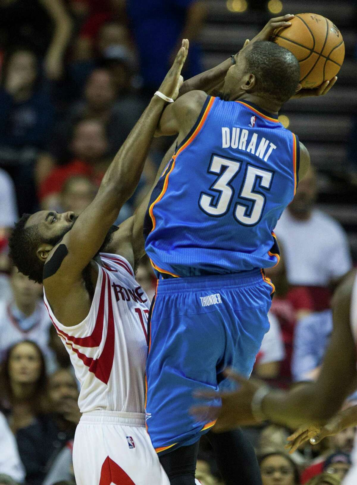 Houston Rockets guard James Harden (13) defends a shot by Oklahoma City Thunder forward Kevin Durant (35) during the second half of an NBA basketball game at Toyota Center Monday, Nov. 2, 2015, in Houston. The Rockets beat the Thunder 110-105. ( Brett Coomer / Houston Chronicle )
