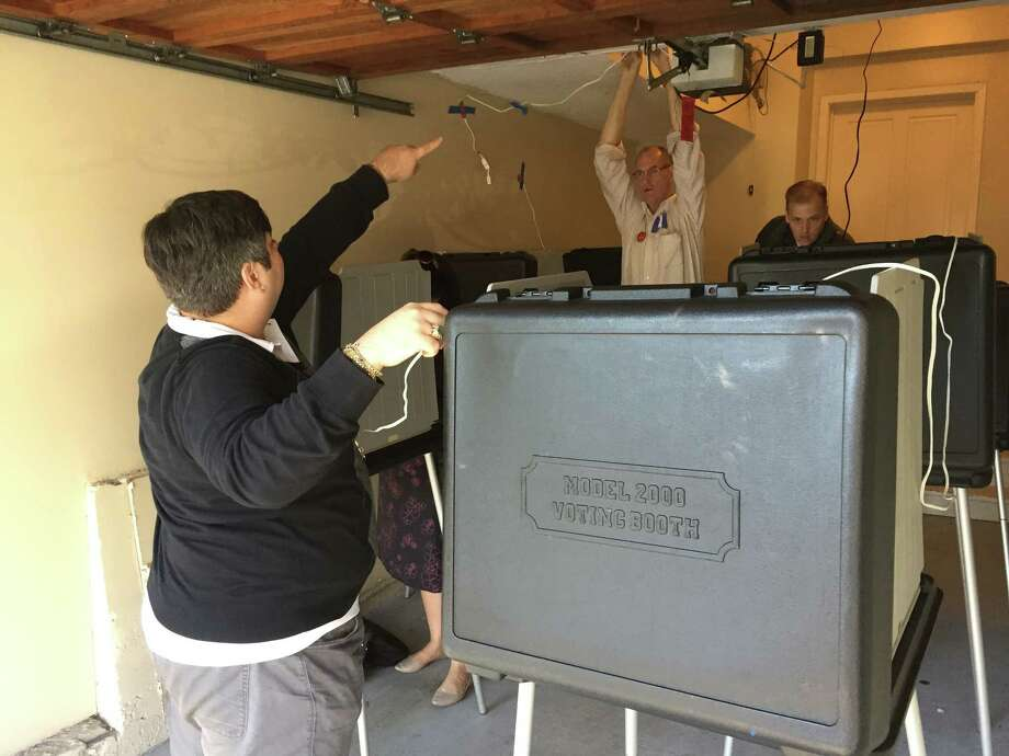 Roman Oganesian works to get a polling place on San Francisco's Telegraph Hill running smoothly early Tuesday