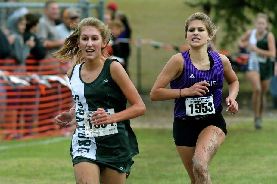 Stratford freshman Grace Custer (1004) and Willis junior Cayden Nesom (1953) push to the finish line where they finished 4th and 5th respectively in the Class 5A Girls 5K Run at the UIL Region III Cross Country Chanpionships at Kate Barr-Ross Park in Huntsville on Oct. 26, 2015. (Photo by Jerry Baker/Freelance)4 Photo: Jerry Baker, Freelance
