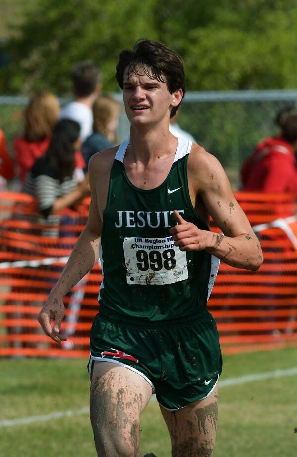 Strake Jesuit senior Andrew Hebert pushes to the finish line during the Class 6A Boys 5K Run at the UIL Region III Cross Country Championships at Kate Barr-Ross Park in Huntsville on Oct. 26, 2015. (Photo by Jerry Baker/Freelance)4 Photo: Jerry Baker, Freelance