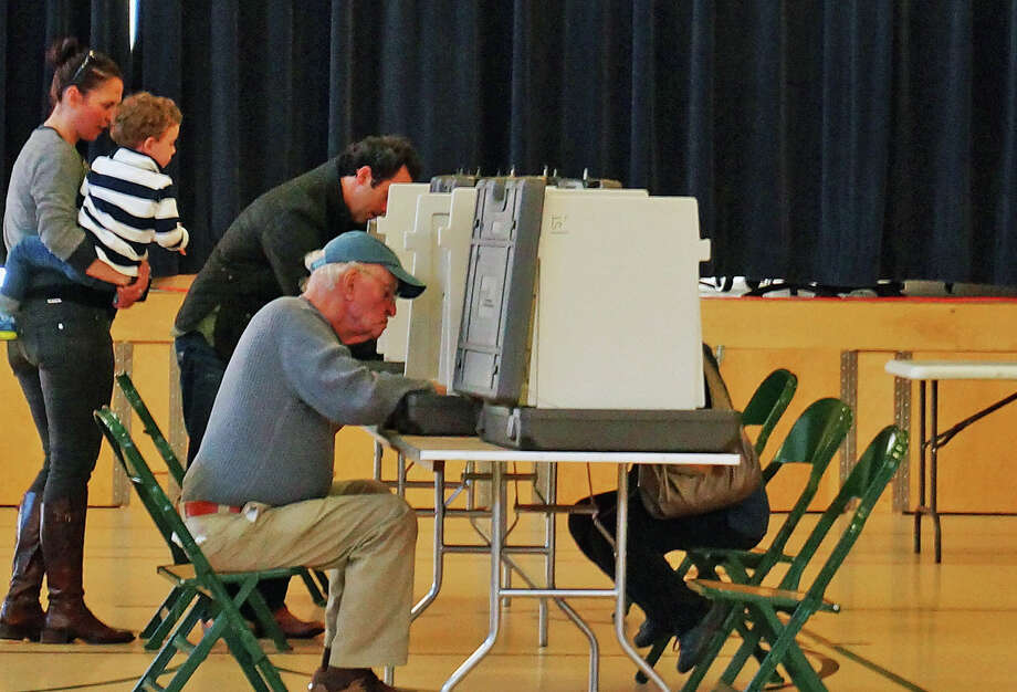 Residents cast their ballots at McKinley School Tuesday afternoon. Voter turnout remained steady throughout the morning. Photo: Genevieve Reilly / Hearst Connecticut Media / Fairfield Citizen
