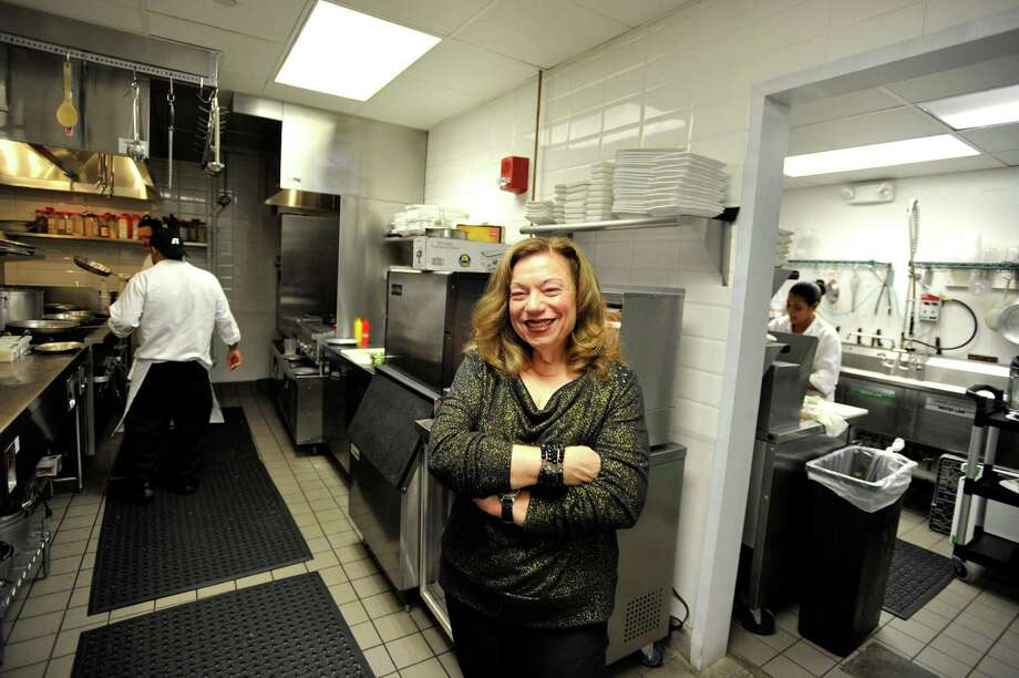 "Cilantro co-owner Marion Scalfari in the kitchen on Wednesday, Oct. 21, 2015. With his new downtown Stamford location of ""Latin fusion"" eatery Cilantro on the heels of the flagship restaurant in Norwalk, owner Alejandro Montoya hopes in time to replicate the success story of Barcelona, which has been able to expand both inside and outside the region. Photo: Michael Cummo / Hearst Connecticut Media / Stamford Advocate"