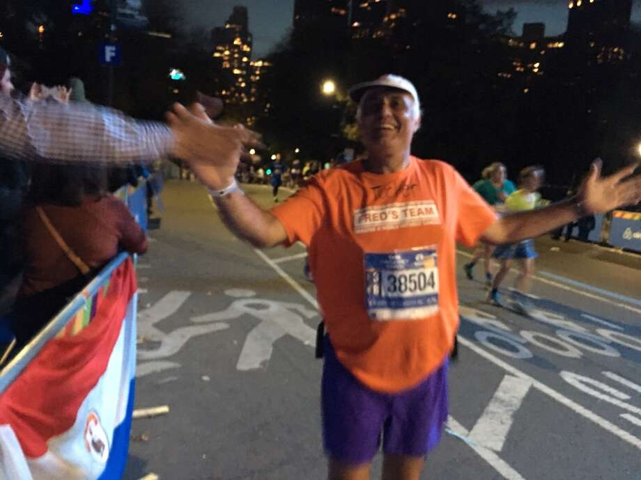 Hugo Mujica, of Stamford, completed his 100th marathon overall and his 17th in the city on Sunday at the New York City Marathon. Photo: Hugo Mujica/Contributed / Connecticut Post Contributed