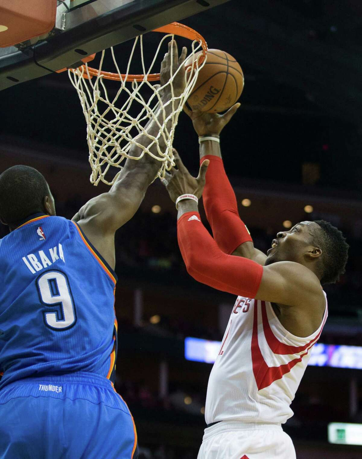 Houston Rockets center Dwight Howard (12) drives in for a layup against Oklahoma City Thunder forward Serge Ibaka (9) during the first half of an NBA basketball game at Toyota Center Monday, Nov. 2, 2015, in Houston. ( Brett Coomer / Houston Chronicle )