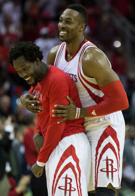 Dwight Howard, right, might play in both ends of a back-to-back with the Kings and Clippers, but Pat Beverley has been ruled out of tonight's game. Photo: Brett Coomer, Staff / © 2015 Houston Chronicle