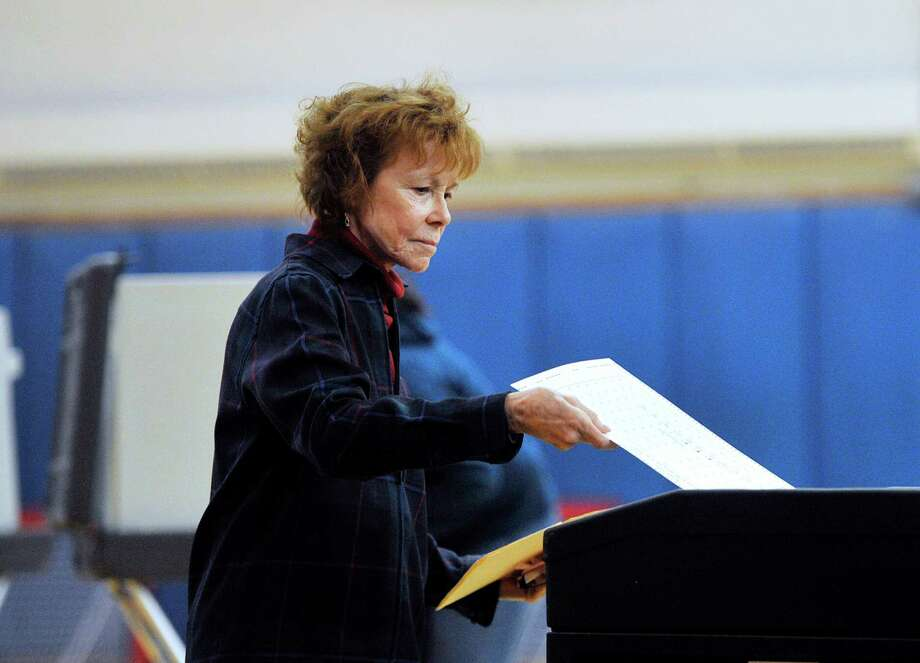 Joan Van Dyke of Greenwich casts her ballot in the gym at Western Middle School, one of the polling places for the election in Greenwich, Conn., Tuesday, Nov. 3, 2015. Photo: Bob Luckey Jr. / Hearst Connecticut Media / Greenwich Time