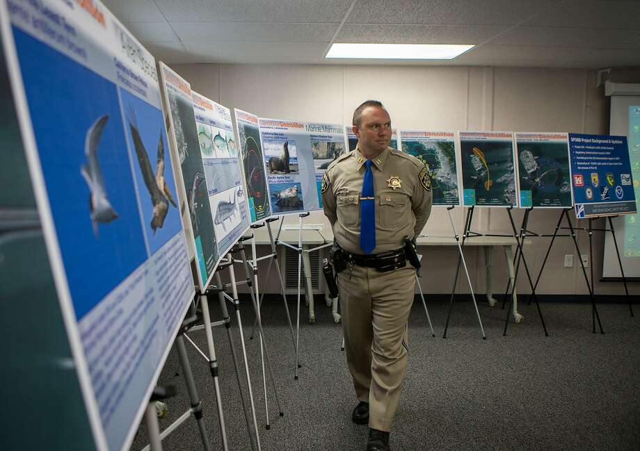 Captain Christopher Sherry, California Highway Patrol Commander of San Francisco Area, walks by environmental information posters at a media briefing regarding the pier E3 implosion planned for November 14 on Tuesday, Nov. 3, 2015 in Oakland, Calif. Photo: Nathaniel Y. Downes, The Chronicle