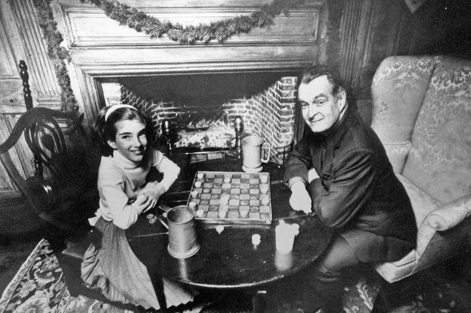 "Sarah, 10, and Arthur Tuthill, of Chapel Lane, Riverside, play checkers in the parlor of the Bush-Holley House on Dec. 18, 1983. Checkers, or ""draughts""were generally not played by children, but by men who often gambled substantially on the outcome. In the late 19th-century, board games such as draughts, backgammon, cribbage and chess were considered betting games and the province of adults. Photo: Contributed Photo"