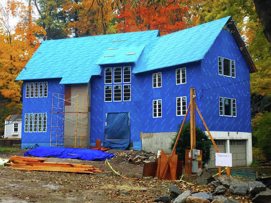 The Big Blue House on Old Church Road in Greenwich is wrapped in Blueskin, a new adhesive house wrap designed to revolutionize the construction process. The home is the first in Greenwich to use the new product. Photo: Contributed / Contributed Photo / Greenwich Time Contributed