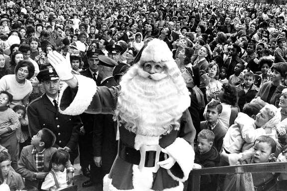 The Emporium Santa leads his followers on Market Street. Nov. 7, 1964.