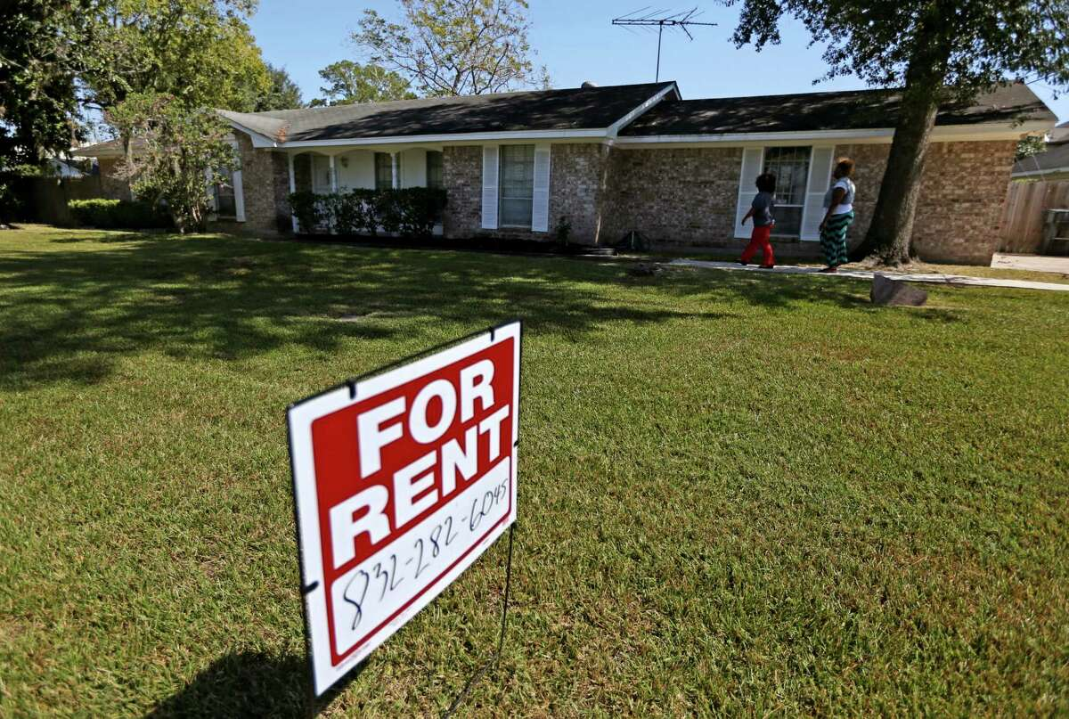 Jessica Vaughn, 35, and cousin Tonya Bias, look at a three bedroom house for rent along Bayou View Drive Friday, Oct. 16, 2015, in Houston, Texas. The house is priced at $1600 per month, her voucher is for a maximum of $1261. She was later told by the owners her application would not make a good fit. Jessica was laid off two-years-ago, forcing her to lose her apartment and move into her mother's two bedroom apartment with her four children. Vaughn has a Housing Choice Voucher from the Harris County Housing Authority to help subsidize rent for an apartment or a house.