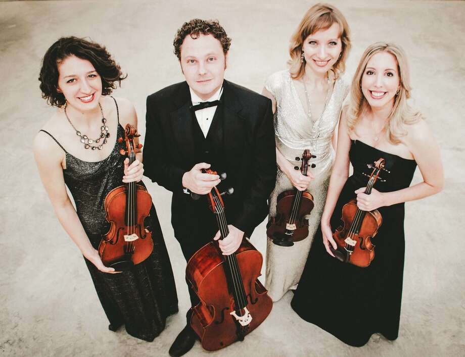 The Axiom Quartet - violist Nina Bledsoe, from left, cellist Patrick Moore and violinists Dominika Danciewicz and Ingrid Hunter -  has become a fixture on Houston's classical music scene. Photo: Axiom