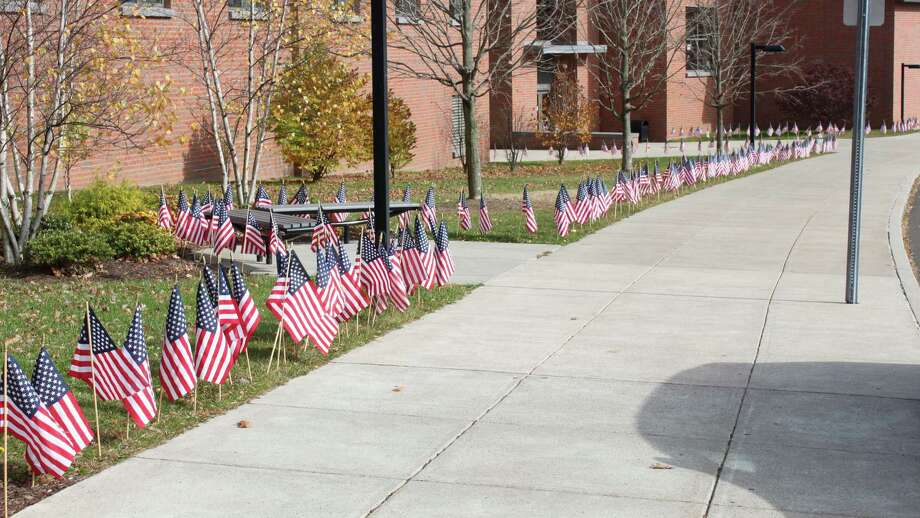 The Darien High School grounds were decorated with U.S. flags for Veterans Day in 2013. Photo: Contributed Photo / Contributed / Darien News