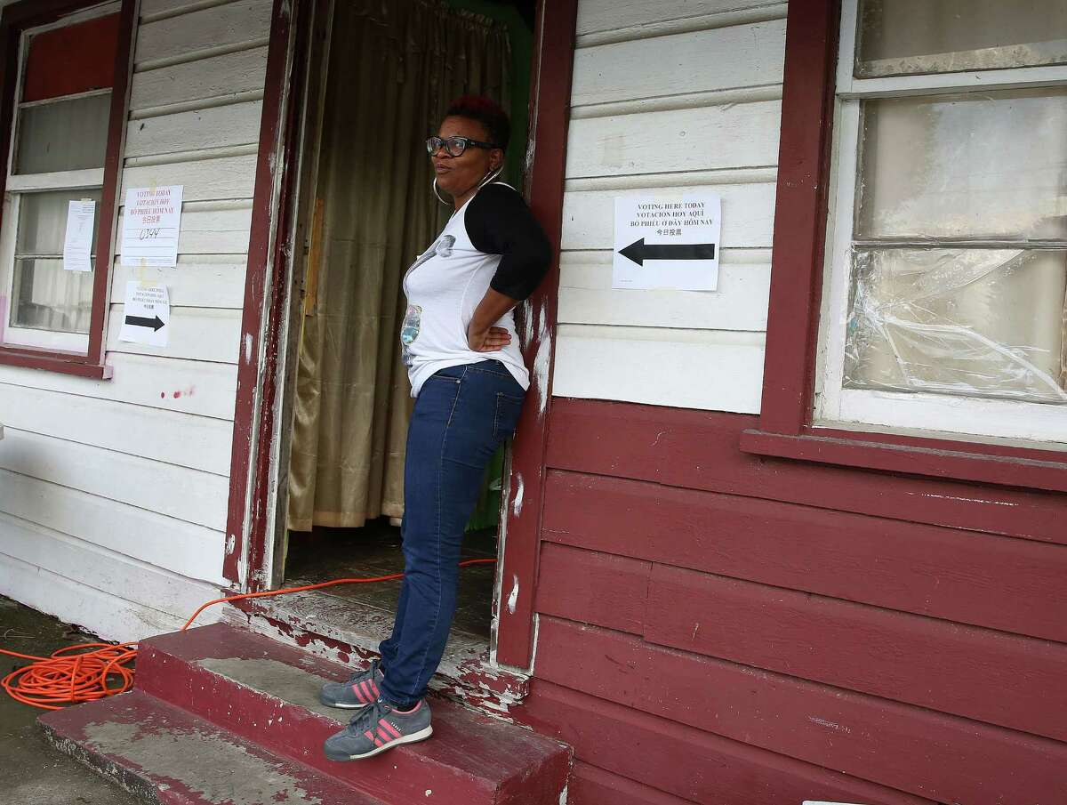 McCan stands in the doorway of her polling station to cool off. The center was having power issues, and couldn't run the A/C.