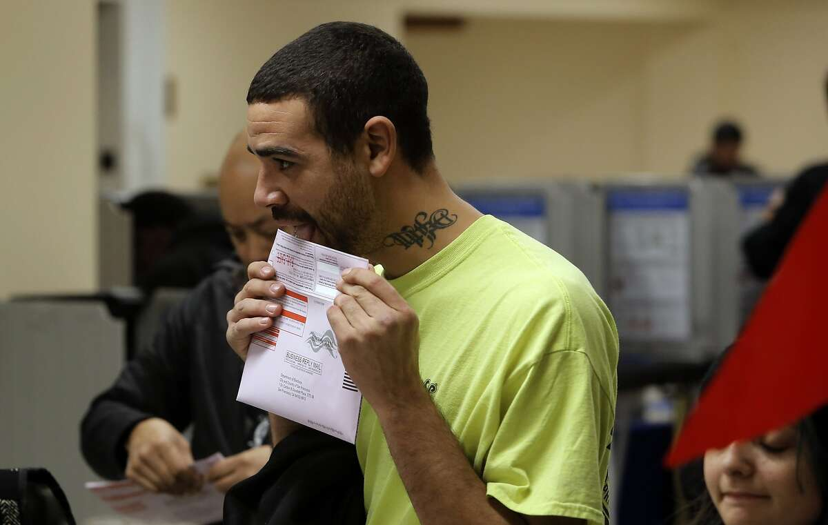 Voter Nick Parker seals his ballot after voting at the City Hall polling place, during election day in San Francisco , Calif. on Tues. November 3, 2015.