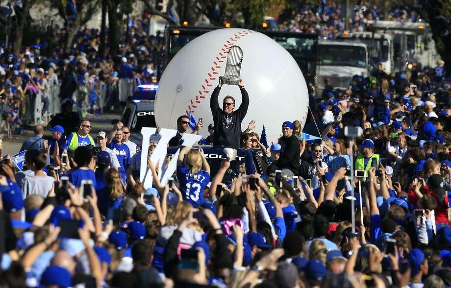 Royals' manager Ned Yost holds the World Series trophy aloft during his team's victory parade through a crowd estimated at 800,000 in downtown Kansas City. Photo: Orlin Wagner, Associated Press