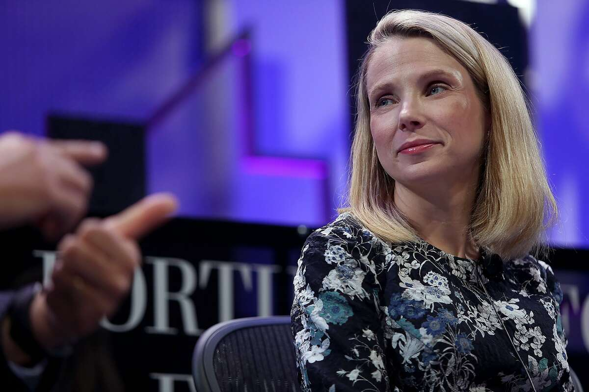 Yahoo CEO Marissa Mayer listens to Salesforce CEO Marc Benioff during the Fortune Global Forum conference in San Francisco on Nov. 3, 2015.