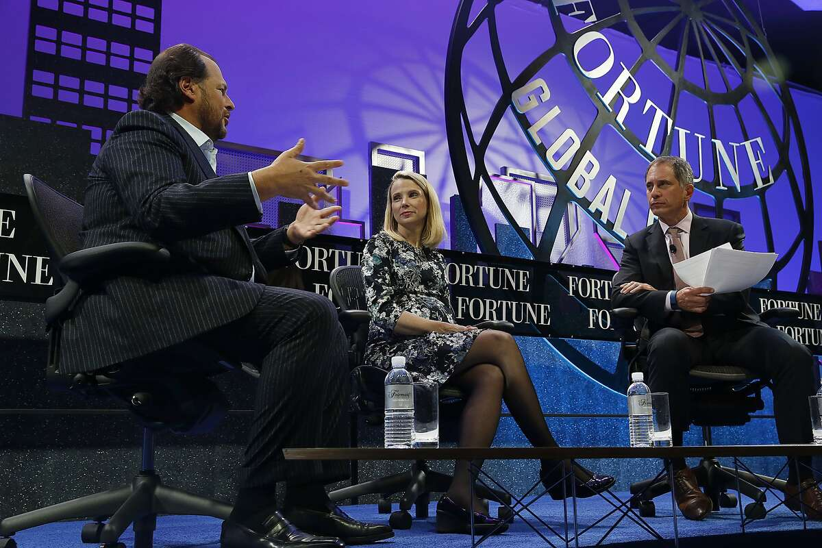 Yahoo CEO Marissa Mayer (middle) speaks with Salesforce chairman and CEO Marc Benioff (left) at the Fortune Global Forum conference in San Francisco, Calif., on Tuesday, November 3, 2015.