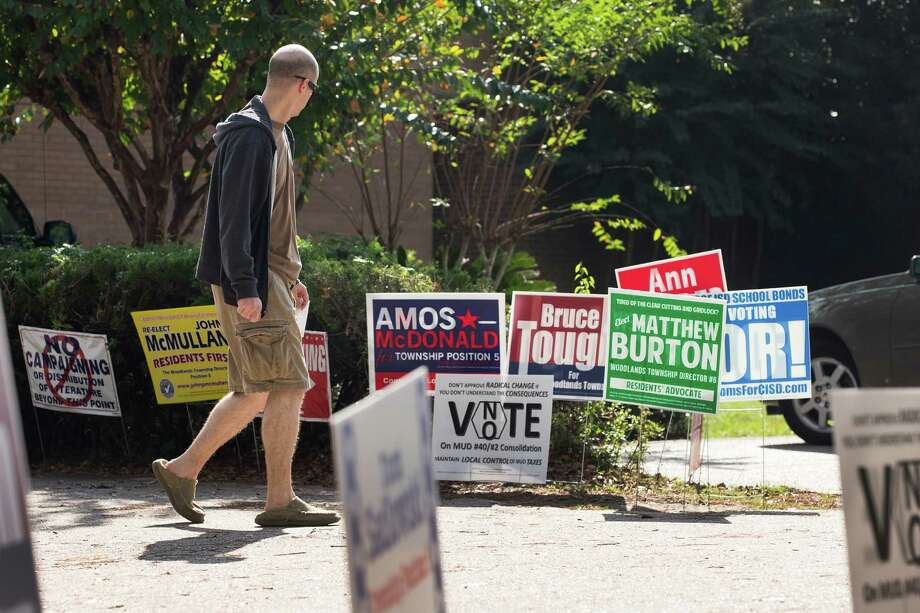 Campaign signs line the parking lot outside the polling place at Glen Loch Elementary on Tuesday, Nov. 3, 2015, in The Woodlands. Photo: Brett Coomer, Houston Chronicle / © 2015 Houston Chronicle
