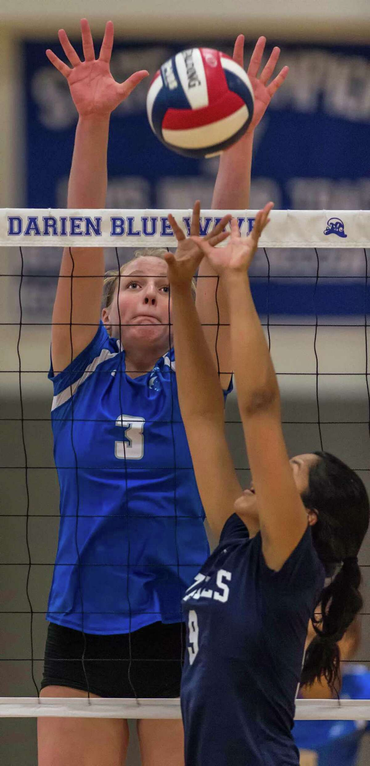 Staples High Schools Maya Lawande sets the ball as Darien High Schools Isabelle Taylor goes up to block the ball during an FCIAC girls volleyball tournament match played at Darien High School, Darien, CT Tuesday, November 3, 2015.