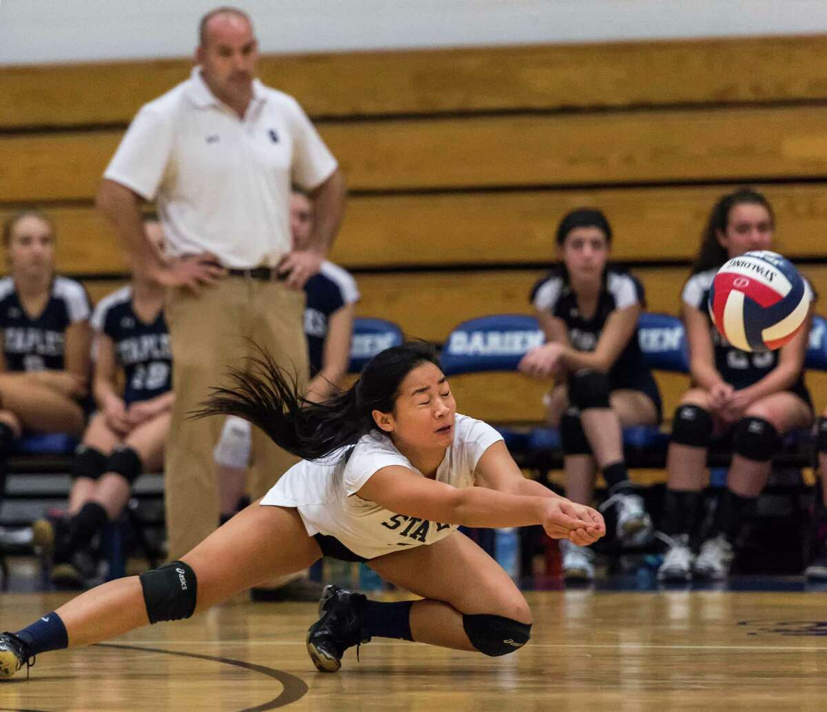 Staples High Schools Vanessa Engdives for the ball during an FCIAC girls volleyball tournament match against Darien High School played at Darien High School, Darien, CT Tuesday, November 3, 2015.