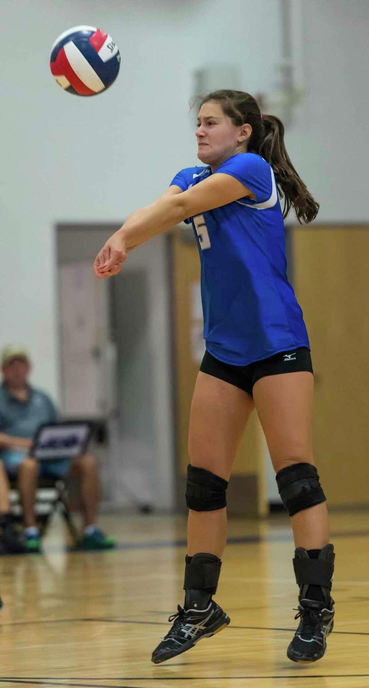 Darien High Schools Anna Barsanti returns a serve during an FCIAC girls volleyball tournament match against Staples High School played at Darien High School, Darien, CT Tuesday, November 3, 2015.